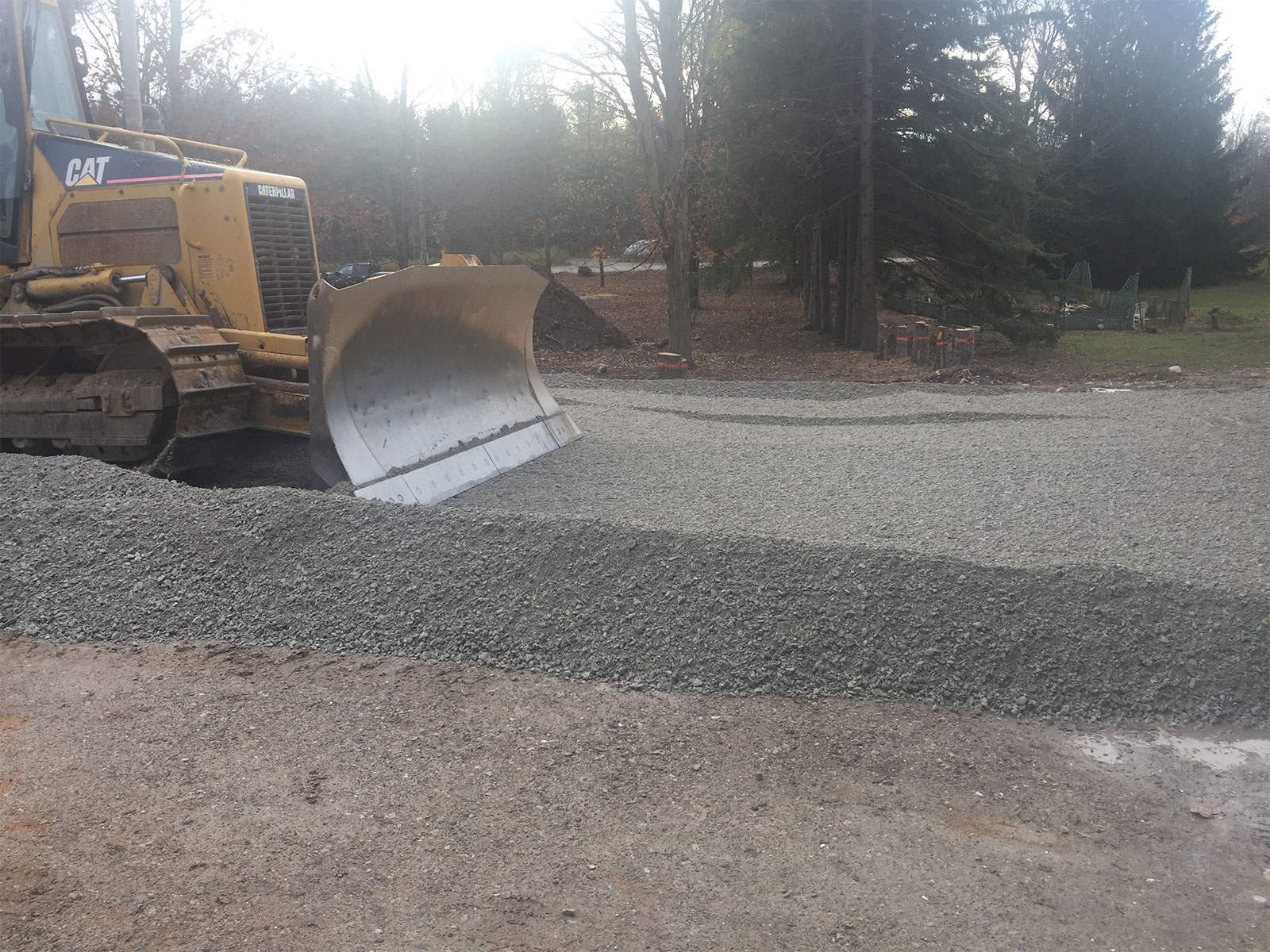 Grading driveway aggregate with Cat Dozer