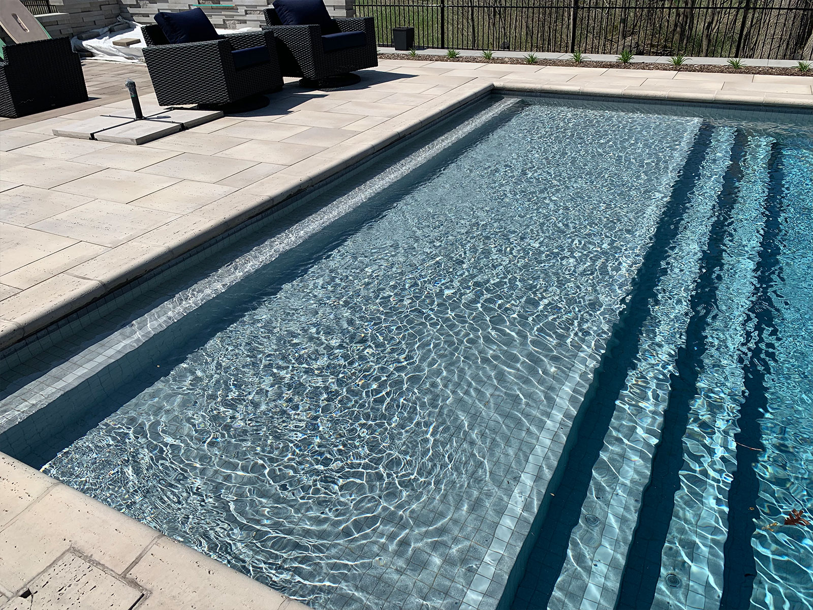 Tiled concrete pool steps and lounge